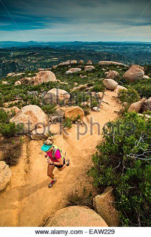 April 9 2014: A girl in athletic wear runs up the Mt. Woodsen Trail outside of San Diego CA. - Stock Photo