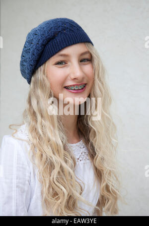 Photo of beautiful young blond girl with braces - Stock Photo