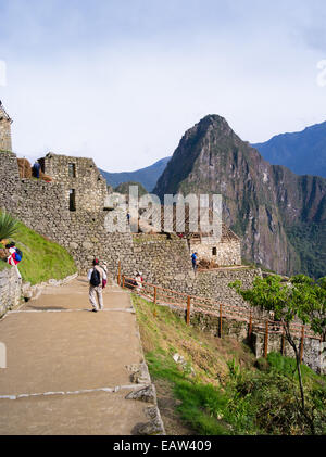 Arriving at Machu Picchu and catching one of your first glimpses ofthis wonderful Incan ruins. - Stock Photo