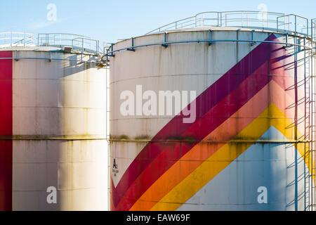 Colorful petrochemical storage tanks used for storing liquid gasses, La Souterraine, La Creuse Department, Limousin, France