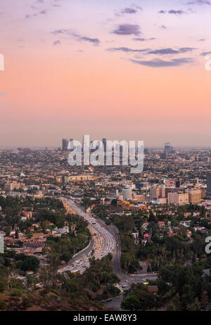Los Angeles city downtown skyline across Hollywood. Freeway 101. View from Hollywood Bowl Overlook at Mulholland - Stock Photo