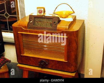Very old radio receiver at the museum Terug in de Tijd - Stock Photo