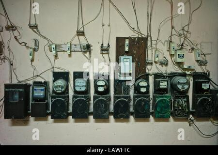 Electricity counters in the lobby of a building in Old Havana. - Stock Photo