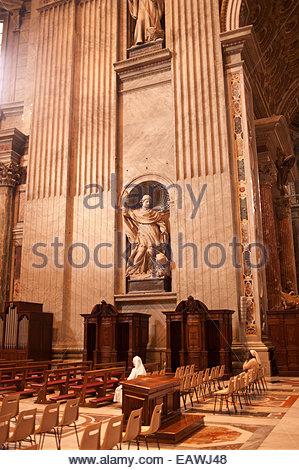 Nuns worship at Saint Peter's Basilica, Vatican City. - Stock Photo