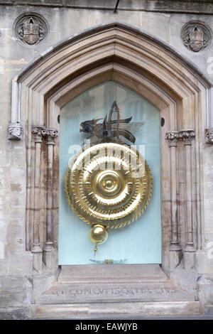 UK, Cambridge, the 24 carat gold Corpus Christi College clock. - Stock Photo