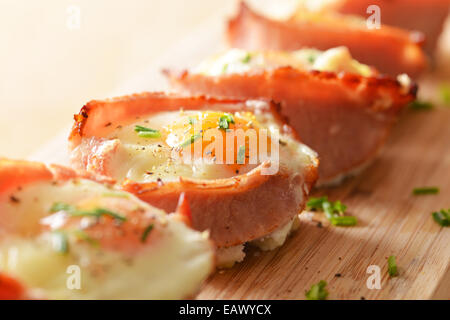Egg and bacon cupcakes served and ready to eat. - Stock Photo