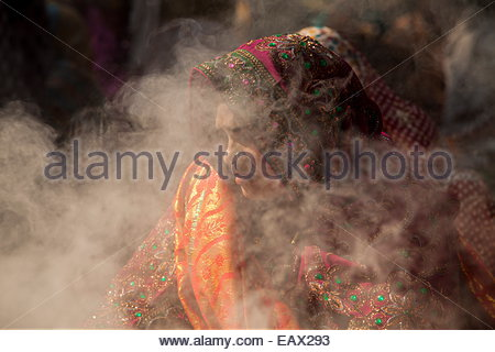 Incense smoke at a Hindu marriage ceremony in the Sacred Garden near the Buddha's birthplace. - Stock Photo