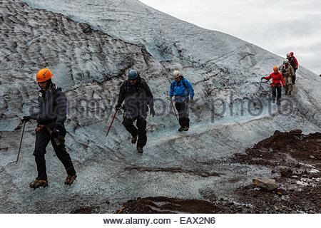 Tourists hiking on Vatnajokull glacier, Iceland's largest, and one of the largest in Europe. - Stock Photo