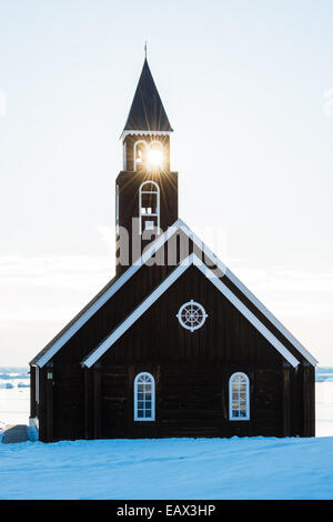 Sunlight through the steeple of a church in winter - Stock Photo