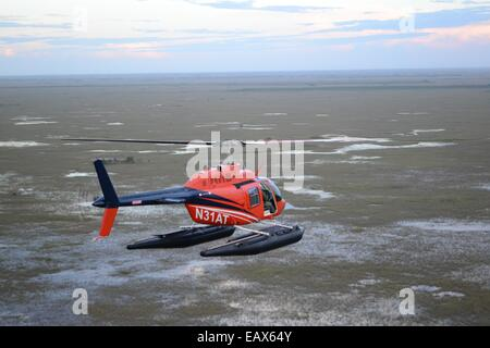 A research helicopter flies over the Everglades National Park during the Environmental Protection Agency Everglades - Stock Photo