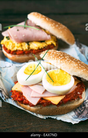 Scramble egg sandwich with cheese in bun - Stock Photo