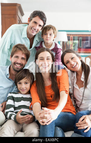 Family together in living room, portrait - Stock Photo
