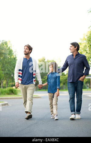 Fathers and son walking together outdoors - Stock Photo