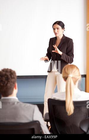 Businesswoman giving presentation - Stock Photo