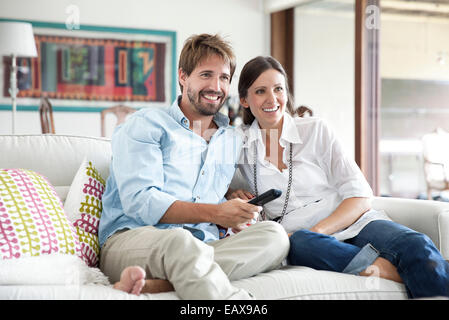 Couple watching TV together - Stock Photo