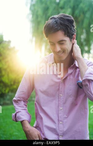 Man enjoying moment of self reflection during walk through park - Stock Photo