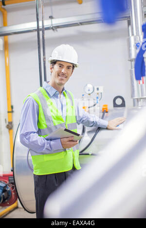 Engineer working in industrial plant, portrait - Stock Photo