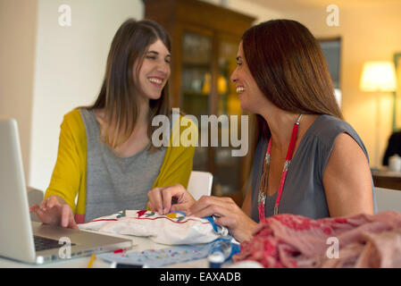 Friends doing embroidery together - Stock Photo