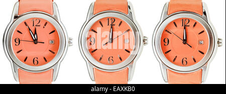 set of orange wristwatches with midnight time isolated on white background - Stock Photo