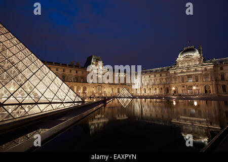 Louvre museum and pyramid night view in Paris - Stock Photo