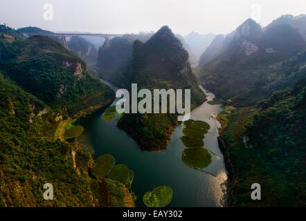 Bridge across the gorges of Guizhou province, China - Stock Photo