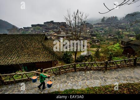 Miao woman in XiJiang, Guizhou province, China - Stock Photo