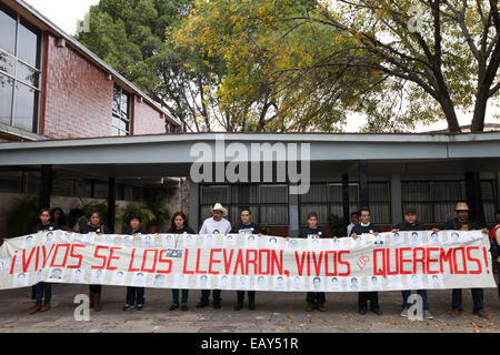 Parents and relatives of the 43 missing students from Ayotzinapa's teacher training college during a protest - Stock Photo