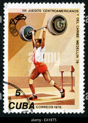 CUBA - CIRCA 1978: A stamp printed in CUBA shows weightlifter, with inscription and name of series 'XIII Central - Stock Photo