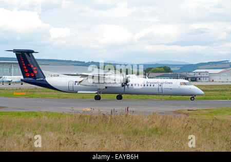 Bombardier DHC-8-402 Q400 of Brussels Airlines departing Inverness Dalcross, airport. Scotland. SCO 9184. - Stock Photo
