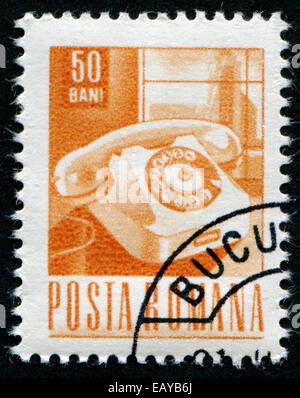 ROMANIA - CIRCA 1967: A stamp printed in Romania Shows Telephone, circa 1967 - Stock Photo
