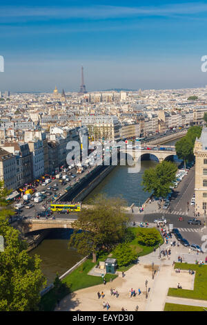 View of Paris, Petit Pont, Pont Saint-Michel and Tour Eiffel from Notre Dame cathedral - Stock Photo