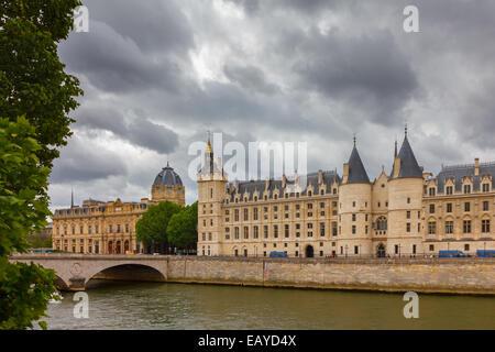 Pont au Change over the Seine River,  Palais de Justice and the Conciergerie in Paris, France - Stock Photo