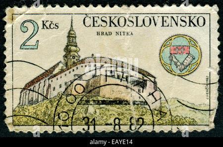 CZECHOSLOVAKIA - CIRCA 1982: The stamp printed in Czechoslovakia shows an ancient castle, circa 1982 - Stock Photo