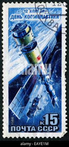 USSR - CIRCA 1988: A stamp printed in the USSR devoted International Day dedicated to space, circa 1988. Large space - Stock Photo