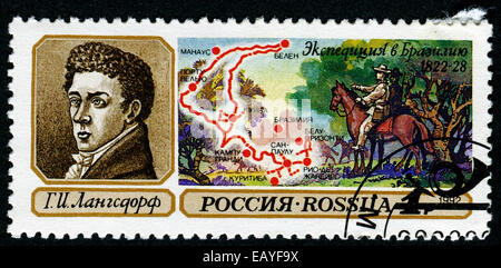 USSR - CIRCA 1992: stamp printed in USSR shows portrait of langedorf and map of Brazil - Stock Photo