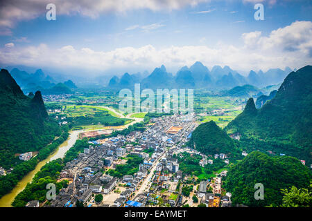 Xingping, Guangxi, China at Li River with karst mountain landscape. - Stock Photo