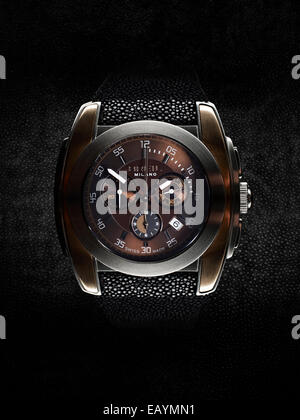 Studio still life image of a Briel chronograph watch with shagreen strap on black shagreen background. - Stock Photo