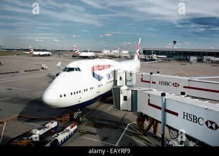 British Airways Jumbo Jet 747 parked at Heathrow Airport - Stock Photo