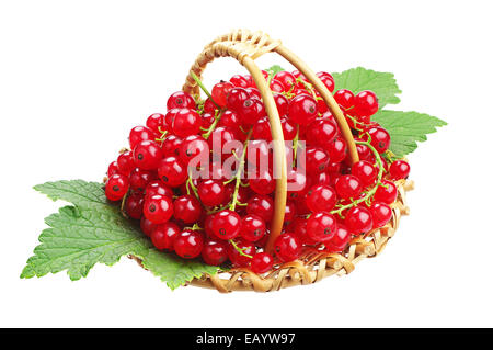 Red currants and green leaves in small wicker basket isolated on white background - Stock Photo