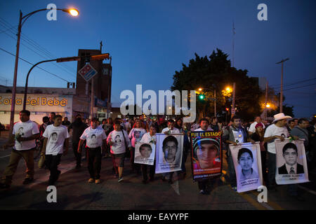 Parents and relatives of the 43 missing students from Ayotzinapa's teacher training college during a march - Stock Photo