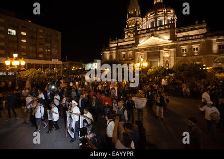 Parents and relatives of the 43 Ayotzinapa's missing students and demonstrators during a march in Guadalajara - Stock Photo