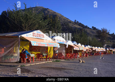 Many fish restaurants (serving mainly trout) along the Costanera Avenue on the shore of Lake Titicaca in Copacabana, - Stock Photo