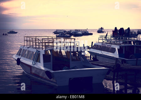 Motorboats docking at wooden jetty on the shore of Lake Titicaca in the harbor of the small tourist town of Copacabana, - Stock Photo