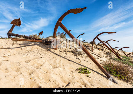 Cemetery of anchors on the beach at Praia Do Barril in Santa Luzia, Algarve, Portugal, Europe - Stock Photo
