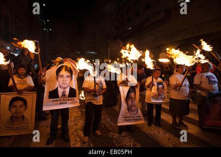 Parents and classmates of the 43 missing students from Ayotzinapa's teacher training college during a march in Guadalajara - Stock Photo