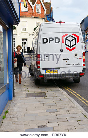 DPD delivery van parked on pavement, double yellow lines, Blandford, Dorset, England UK - Stock Photo