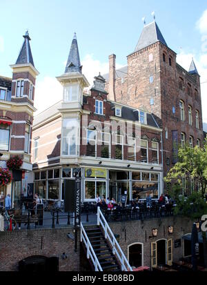 Oudegracht canal in the  old  inner city of  Utrecht, The Netherlands with Medieval manor  'Stadskasteel Oudaen' - Stock Photo