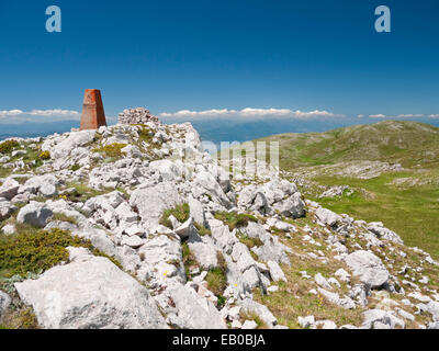 Border marker post Kota F10 between Albania and Macedonia, in Galicica National Park, FYR Macedonia - Stock Photo