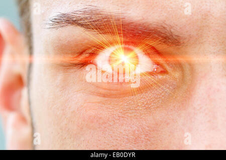 Red laser ray on eye - Stock Photo