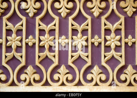Lovely pattern containing geometrical and floral design on wall at City Palace, Udaipur, Rajasthan, India, Asia - Stock Photo